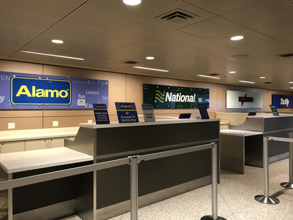 Alamo rent a car airport counter and national Dallas Love Field airport DAL