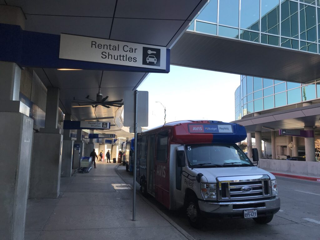 Dallas Love Field airport DAL sign to free shuttle bus to car rental center